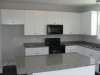Kitchen w/ granite tops, full overlay shaker cabs